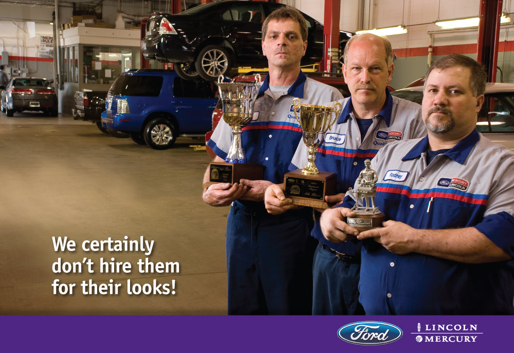 image of auto mechanics holding awards