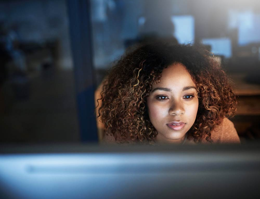 black woman looking at monitor for a Columbus Oh website design firm