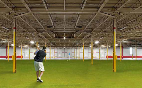 Columbus website design firm's example of golfer inside a warehouse