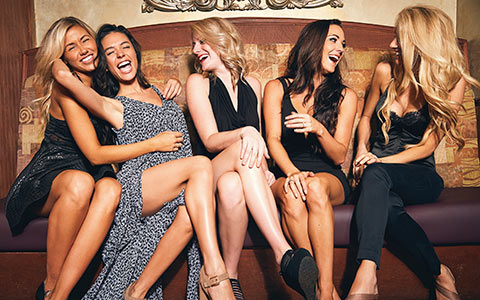 group of women laughing from NutraGlow's homepage