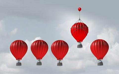5 hot air balloons with one rising higher than the others Columbus web design firm