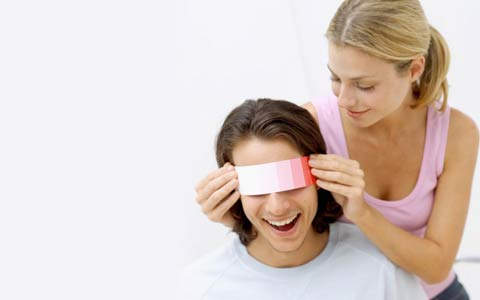 direct marketing example of woman covering a man's eye with paint strip