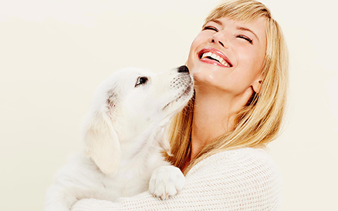 woman with puppy from kybella website by Columbus web design firm Sevell
