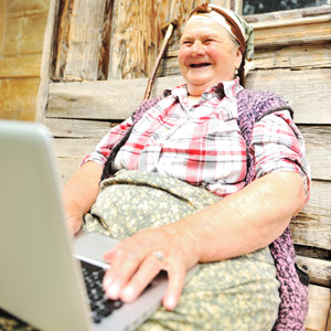 Old frumpy woman from eastern Europe on a laptop