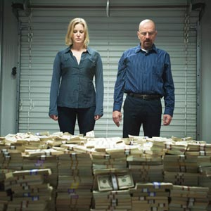 from tv show Breaking bad, Skyler and Walter and pile of money in a storage shed