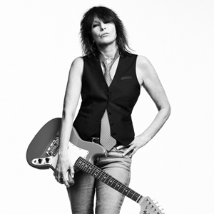 chrissie hynde with guitar and how it relates to the website design firm Sevell