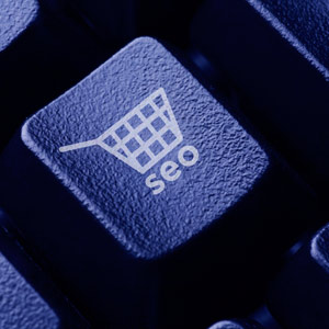 close up of computer key with image of shopping cart and letters SEO on key