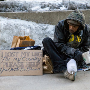 photo of homeless man in Chicago with new attractive sign asking for help