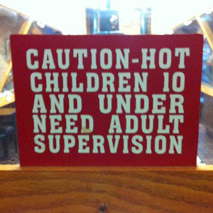 "sign inadvertanty calling children under 10 ""hot"""