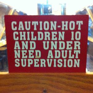 "sign inadvertanty calling children under 10 ""hot"""