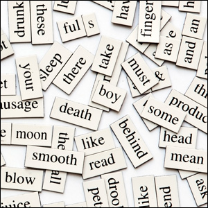 group of magnetic words jumbled on a white surface