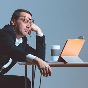 man asleep at laptop by Columbus website design firm Sevell