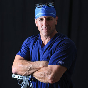 photo of Dr. Brett Osborn in his scrubs and operation gear