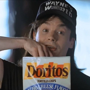 photo of Mike Myers from Wayne's World eating Doritos