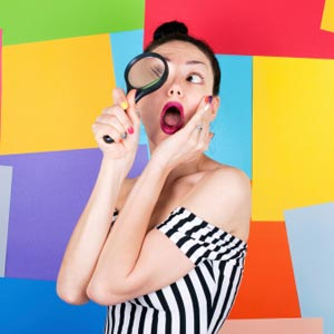humorous photo of woman searching with magnifying glass