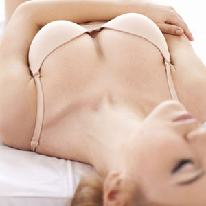 photo from website showing woman in bed with lovely breasts picked by Columbus Ohio web design firm