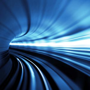 abstract image of tunnel made up of light looking like high speed travel