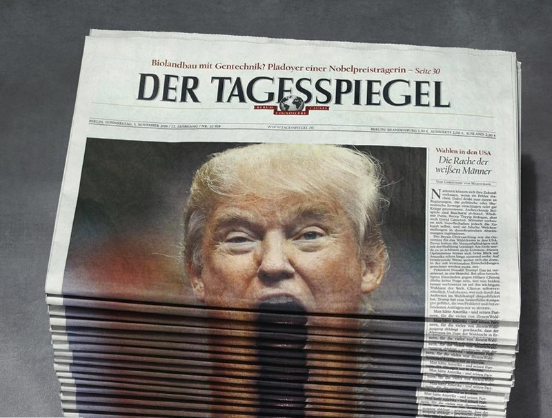 front page of German newspaper folded showing Trumps face above-the-fold