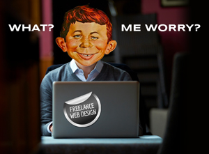 Alfred E Newman at a laptop computer